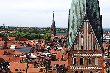 View from the water tower on the Old Town, St. Johannis church in the front, in the back the St. Nikolai church, Lueneburg, Lower Saxony, Germany, Europe