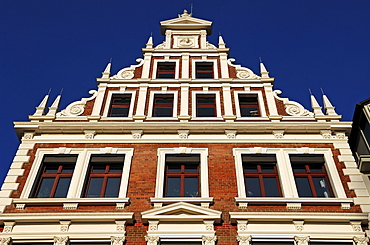 Old decorative house front of a community house against a blue sky, Lueneburg, Lower Saxony, Germany, Europe
