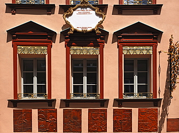 Decorative and renovated facade with tile reliefs of craftman's trades in the historic town centre, Nuremberg, Middle Franconia, Bavaria, Germany, Europe