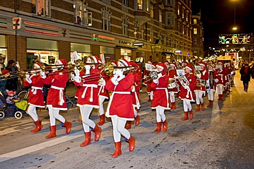 Christmas parade with young girls playing brass band music, Copenhagen, Denmark