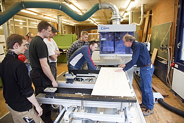Specialist lecturer demonstrating a computer numerical control (CNC) milling machine, Master Craftman School of the Chamber of Small Industries and Skilled Trades for carpentry, Dusseldorf, North Rhine-Westphalia, Germany, Europe