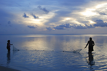 Fishermen at sunset, Aitutaki Atoll, Cook Islands, Pacific Ocean