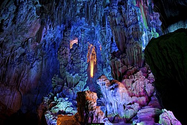Colourful illumination in the largest stalactite cave of Guilin, the Reed Flute Cave, Guilin, Guangxi, China, Asia