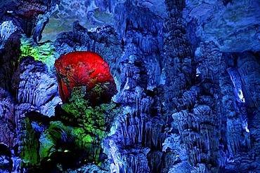 Varied lighting in the largest stalactite cave of Guilin, the Reed Flute Cave, Guilin, Guangxi, China, Asia