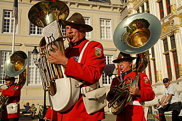 Brass band Groep Sint Leo marching through the historic center of Bruges, Belgium, Europe