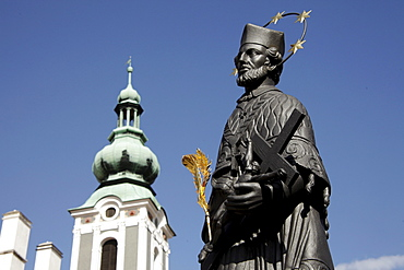 Statue of Saint John of Nepomuk on Lazebnicky Most bridge and St. Jost Church, &esk˝ Krumlov, Czech Republic, Europe