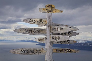 Signpost showing the distance to several cities, skiing area on Fagernes-Fjellet Mountain above Narvik and Ofotfjord, Narvik, Norway, Europe