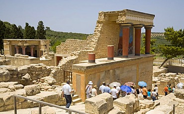 Tourists visiting the arcade of columns at the northern entrance of the palace on the grounds of the Minoan excavation of Knossos, Heraklion, island of Crete, Greece, Europe
