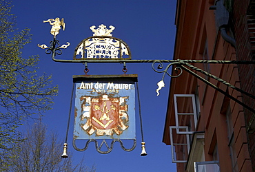 Craftsman advertising panel reading Amt der Maurer on a building in the historic town, Moelln, Holstein, Schleswig-Holstein, Germany, Europe