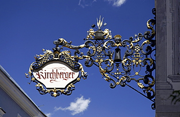 Handcrafted advertising sign of a shop, in a town alley, Bruneck, Val Pusteria, Alto Adige, Italy, Europe