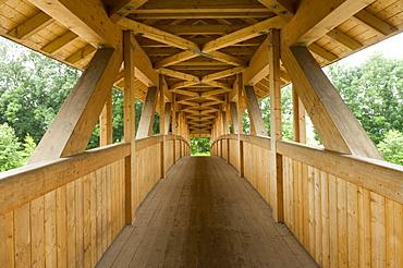Wooden bridge over Loisach River in Garmisch-Partenkirchen, Bavaria, Germany, Europe