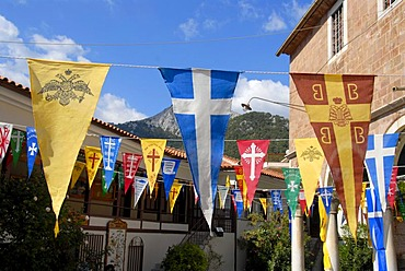 Greek Orthodox Christianity, colourful banners, pennants, on a church in the mountain village of Agiassos, Lesbos, Aegean Sea, Greece, Europe