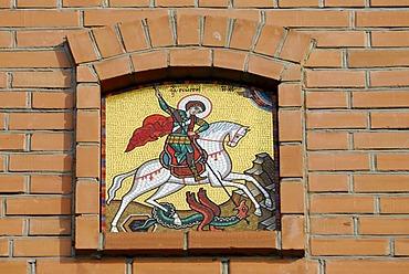 Orthodox icon of Saint George on red brick wall