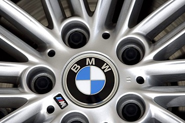 Aluminium wheel rim of a BMW 3 with company logo
