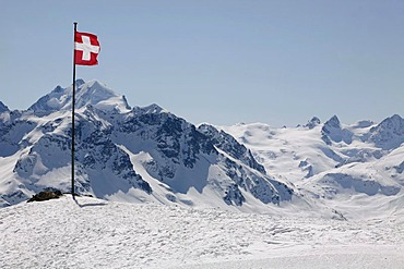 Swiss national flag on the plateau Trais Fluors, St. Moritz, Oberengadin, Graubuenden, Switzerland