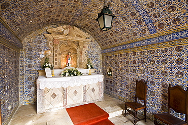 Chapel decorated with ceramic tiles in Fortaleza de Ponta da Bandeira Lagos and the patron saint Santa Barbara in the altar area, Algarve, Portugal, Europe