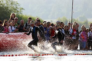 Triathlon, Mirjam Weerd, Netherlands, left, finish line of swimming competition, Ironman Germany, Frankfurt, Hesse, Germany, Europe