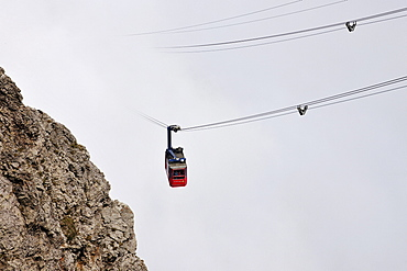 Gondola cableway to Mount Pilatus emerging from a sea of fog, Mount Pilatus, a recreational mountain at Vierwaldstaettersee, Lake Lucerne, near Lucerne, Switzerland, Europe