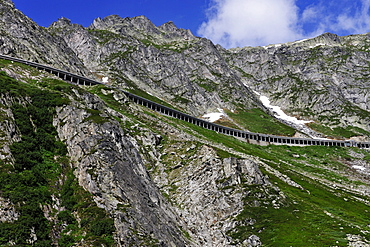 New Gotthardpass Road leading through an open tunnel on the mountain, Switzerland, Europe