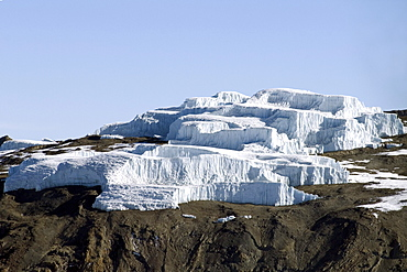 Aerial view of Mt. Kilimanjaro 19335 ft. or 5895 m, spectacular ice cliffs of the Eastern Icefield, Tanzania, Africa