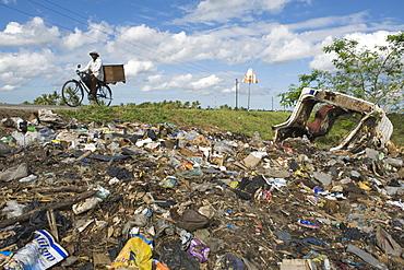 Municipal rubbish dump at the roadside, Quelimane, Mozambique, Africa