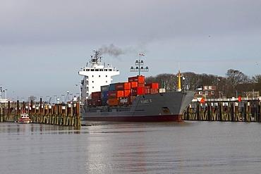 Container ship leaving the lock of the Kiel canal in Brunsbuettel, Brunsbuettel, district Dithmarschen, Schleswig-Holstein, Germany,
