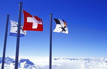Flags of Graubuenden and Switzerland on the summit of Mount Corvatsch near Silvaplana, Engadin, Graubuenden or Grisons, Switzerland, Europe