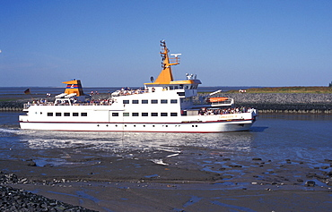 Ferry from the Langeoog island arriving at Bensersiel, ferry service, ship, North Sea, North Sea coast, Lower Saxony, Germany, Europe