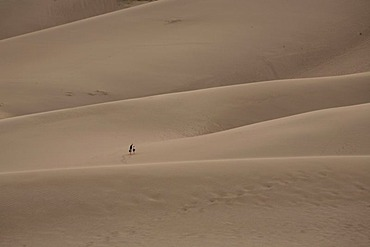 Sand dunes with people, Southern Colorado, USA