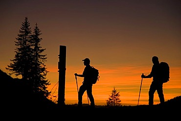 Silhouettes of two hikers, hiking tour in the evening, Styria, Austria, Europe