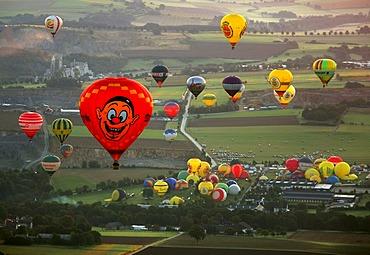 Aerial photograph, hot-air balloons, International Mongolfiade, start at the Warsteiner Brewery, sunset, Hirschberg, Warstein, Sauerland, North Rhine-Westphalia, Germany, Europe