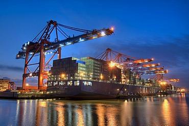 Container ship at night in Hamburg Harbour, container terminal Eurokai, Hamburg, Germany, Europe