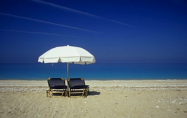 Sunshade, sun loungers, beach in the West of the Island of Kefalonia, Greece, Europe