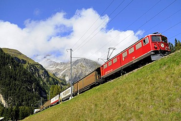 Rhaetische Bahn RhB Railway freight train travelling on the Albula stretch between Berguen and Preda, Graubuenden, Switzerland, Europe