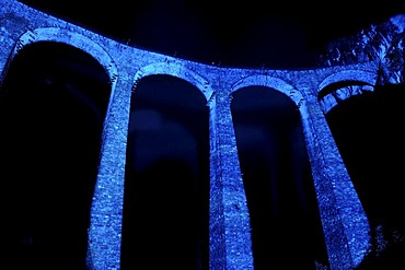 "Irrigation water viaduct lit up to celebrate the acceptance of the ""Rhaetische Bahn Railway in Albula/Bernina"" as a UNESCO World Heritage Site, Filisur, Graubuenden, Switzerland, Europe"