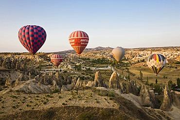 Hot air balloons over Cappadocia, Central Anatolia, Turkey, Asia