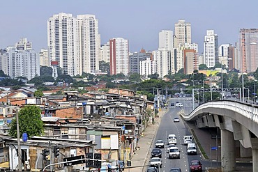 Paraisopolis favela in front of modern skyscrapers, contrast, Morumbi district, Sao Paulo, Brazil, South America