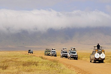 Tourists in several four-wheel-drive vehicles during wildlife observation, Ngorongoro-crater, Ngorongoro Conservation Area, Tanzania, Africa