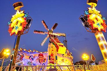 Skater amusement ride at dusk, Octoberfest, Munich, Bavaria, Germany, Europe
