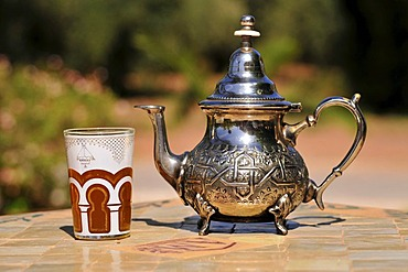 Silver teapot and tea glass with peppermint tea, Menara Gardens, Marrakech, Morocco, Africa