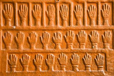 Sati stones, hand imprints of the 15 royal widows of Maharaja Man Singh who committed self-immolation, Mehrangarh Fort, Jodhpur, Rajasthan, India, South Asia