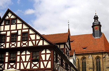 Traditional half-timbered buildings in front of the Collegiate Church, Feuchtwangen, Bavaria, Germany, Europe