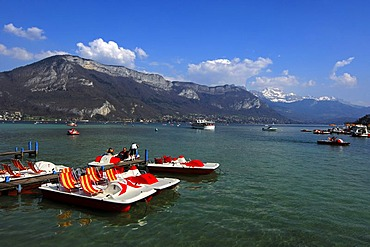 Beginning of the season for paddleboats, early spring day at Annecy Lake, Savoyen, France, Europe