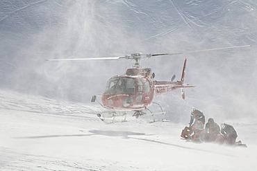 Rescue helicopter landing, Leukerbad ski piste, Valais, Switzerland, Europe