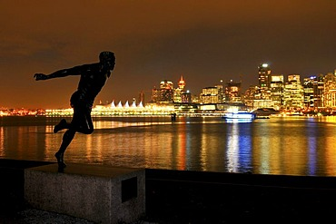 Skyline in front of Coral Harbour, at dusk, and the statue 'the runner', Vancouver, British Columbia, Canada, North America