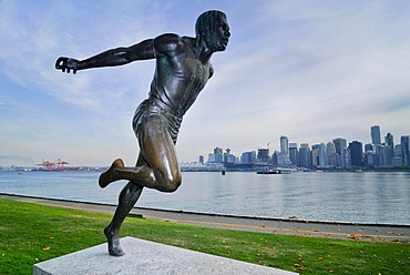 Skyline and Coral Harbour, statue 'the runner', Vancouver, British Columbia, Canada, North America