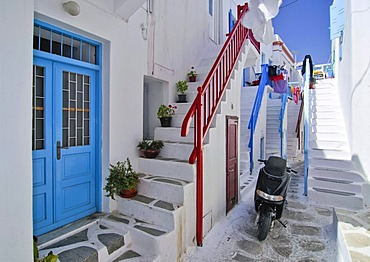 Typical stairways with a motor scooter in a narrow alley in Mykonos, Cyclades, Greece, Europe
