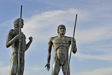 Larger-than-life-sized bronze warrior figures guarding the valley of Vega de Rio de las Palmas beside the road after Betancuria, Fuerteventura, Canary islands, Spain, Europe