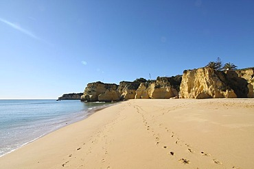Footprints on a beach, Algarve, Portugal, Europe