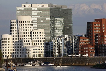 Media Harbour, Neuer Zollhof, buildings designed by the architect Frank Owen Gehry, in front of the Stadttor building, Duesseldorf, North Rhine-Westphalia, Germany, Europe